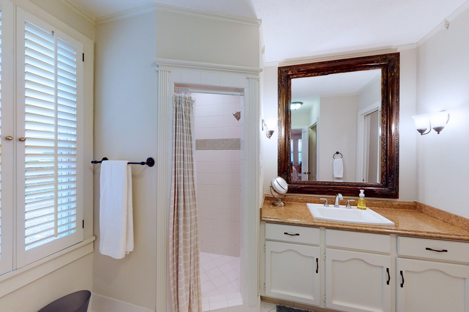 Master bath with oversized tub and walk in shower.